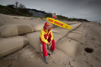 Inverloch Surf Lifesaving club President Warren Cook, pictured here with his daughter Jasmine. When the surf lifesaving club was built 10 years ago, it had no view of the sea but now the water is 30 metres from the door.
