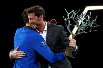Marat Safin (right) presents Novak Djokovic with the Paris Masters trophy earlier this month.