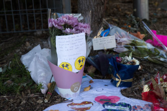 Tributes are left outside Newmarch House aged care facility, where 19 residents died after being diagnosed with COVID-19.