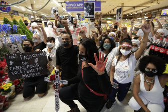 Activists, including members of Black Lives Matter, demonstrate in a Brasilia Carrefour against the killing of black man João Alberto Silveira Freitas at a Carrefour supermarket in Porto Alegre the night before.