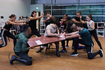 Jason Arrow (centre) and members  of the Australian cast of Hamilton during rehearsals in February.