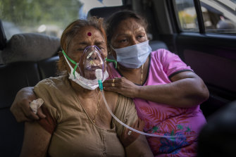A COVID-19 patient receives oxygen inside a car provided by a Gurdwara, a Sikh house of worship, in New Delhi.