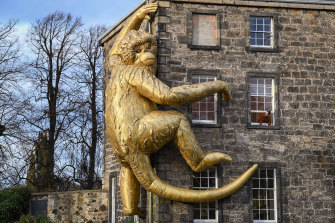 Lisa Roet's Golden Monkey on the side of Inverleith house in Edinburgh, Scotland.