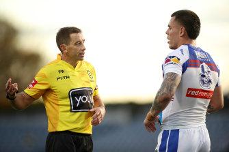 Referee Ben Cummins speaks to David Klemmer at Campbelltown Stadium.