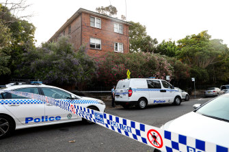 A crime scene was established outside the complex in Balmain East.