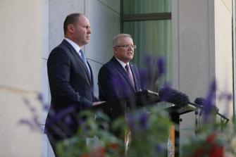 Treasurer Josh Frydenberg and Prime Minister Scott Morrison address the media on Friday.
