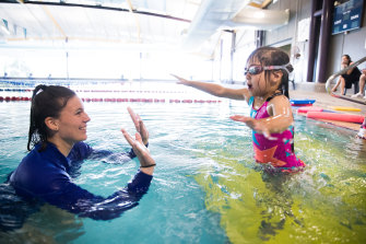 Swimming instructor Melinda with Kay-Li Khor, four, at the Vic Uni pool.