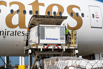 The first shipment of AstraZeneca COVID-19 vaccine is removed from the Emirates airlines plane at Sydney International airport on February 28.