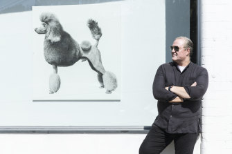 Tim Olsen outside his Woollahra gallery with one of the works in the new show.