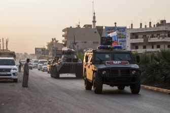 Russian forces patrol in the city of Amuda, north Syria, on October 24.
