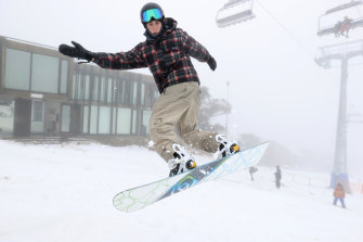 A snowboarder takes a jump at Mt Buller Ski Resort in June.