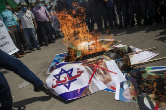 Palestinians in Gaza burn pictures of US President Donald Trump, Israeli PM Benjamin Netanyahu, Bahrain King Hamad bin Isa al-Khalifa and Abu Dhabi Crown Prince Mohammed bin Zayed al-Nahyan, during a protest against the UAE and Bahraini normalisation agreement with Israel.