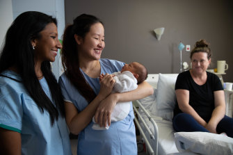 Obstetricians Kaushi Arulpragasam, left, and Stephanie Sii, right, with four-day-old Richie Hicks and his mum, Rhiannon, at the Royal Hospital for Women in Randwick.