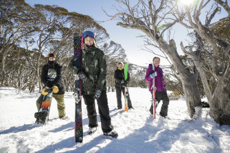 "Mia ""Miff"" Rennie, 15 at the front with brother Kai, 13, (left), mother Nicola and sibling Pip, 9, at Perisher."