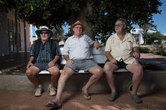 Bill Howlett, Chris Boucher, and Pete Rogers on Cobar's main street. They are speaking out about the local hospital despite concerns about ruffling feathers in the tight-knit community.