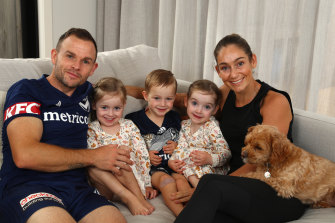 Leigh Broxham, left, with his wife, Sam, right, and their triplets.