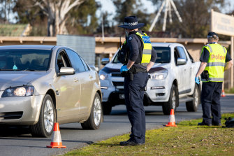 Victoria has shut the border to all of NSW and the ACT. Police stop cars entering a checkpoint between Albury and Wodonga on Sunday.
