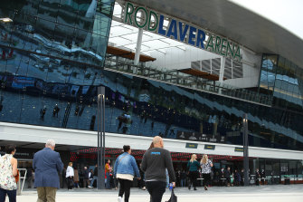 Members of the public arrive at the state memorial at Rod Laver Arena.