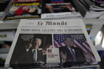 """French newspaper Le Monde led with """"Trump-Biden : the United States is tearing itself apart, Editorial : a democracy in danger""""."""
