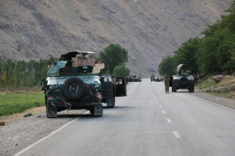 Feeling Afghan soldiers pause on a road at the front line of fighting between Taliban and security forces,  near the city of Badakhshan, northern Afghanistan on Sunday.