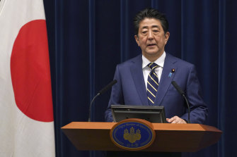 Japanese Prime Minister Shinzo Abe, pictured, could declare a state of emergency as soon as Tuesday.
