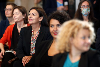 Paris Mayor Anne Hidalgo, centre left, at the council meeting that reelected her in July.