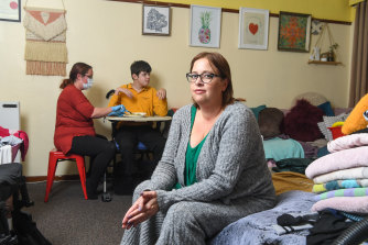 Jess Stevens with her son Jerrah and a carer.