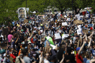 People gather for a rally in Minneapolis, following the death of George Floyd, in May.