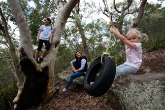 Rachel Chappell with daughters Ella (on swing) and Scarlett playing in their backyard on their new tyre swing.