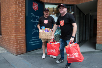 Danny Salsbury (right) has seen rising demand for meals and food hampers.