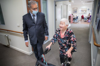 Afif Hadj from Hope Aged Care with resident Mei Mei Chiang, who has lived at the company's Brunswick centre for eight years.