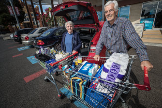 John, 82, and Corinne, 78, Upsher have doubled up on some of their shopping in preparation for the arrival of coronavirus. Pictured here in Flemington.