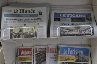 Copies of the French newspapers Le Monde, Le Figaro and others in Paris. The papers are among 121 to receive annual news payments from Google.