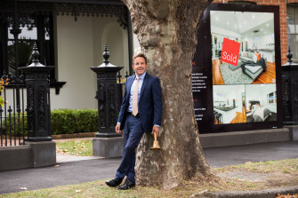 Nelson Alexander auctioneer Ryan Currie outside a house in Flemington that he sold last week for $610,000 above its reserve.