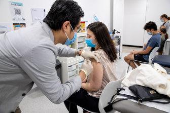 Dr Eric Chan gives Elena Stefanovski her second dose of Pfizer on Sunday.