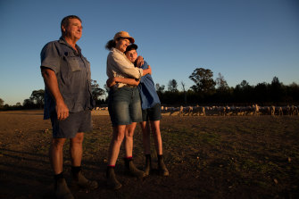 Tracy Blackburn with her partner, Terry Cornish, and son on their farm near Dubbo.