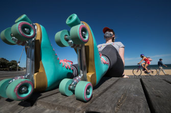 Jessica Maddock wears her skates at St Kilda beach.