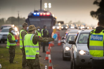 ADF personnel help police at a roadside checkpoint on the Geelong Freeway last week.