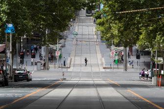 A deserted Bourke Street in locked-down Melbourne.
