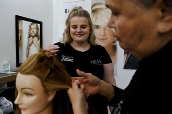 Hairdressing apprentice Lily Wickett, 17, has no regrets about leaving school before completing year 10.