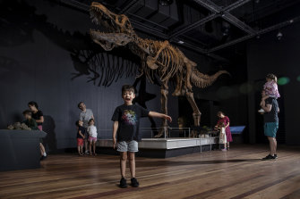 Archie Levins, 6, attended the Tyrannosaur - Meet the Family exhibit with his dad, Andrew (right) and sister.