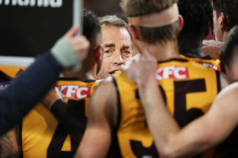 Alastair Clarkson speaks to his players during the clash with Sydney last month.