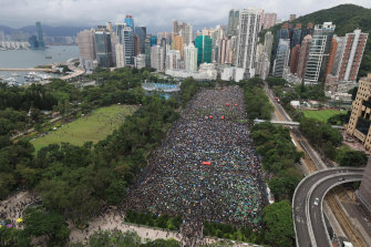 Protesters gather during a rally at Victoria Park in Hong Kong on Sunday.