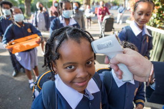 Students at St Brendan's Primary School in Flemington return to school.