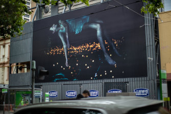 A giant billboard featuring of a girl who seems to float in the sky by Bill Henson is a highlight of the inaugural Uptown festival.
