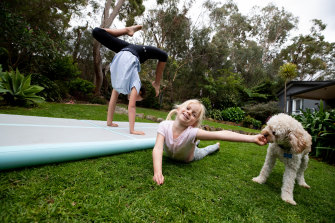 Ella and Scarlett Chappell playing on their inflatable gymnastics mat, a lockdown present that will get plenty of use during the school holidays.