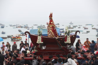 "A Peruvian fishing community carries its patron saint during a Catholic celebration. In the 1600s, fishermen in Peru coined the term El Nino (""little boy"" or ""Christ child"") to describe a weather event that left them low on seafood around Christmas time."