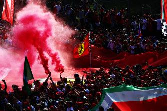 Ferrari fans celebrate the win.