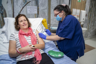 A volunteer takes part in trials of UQ's vaccine candidate in July.