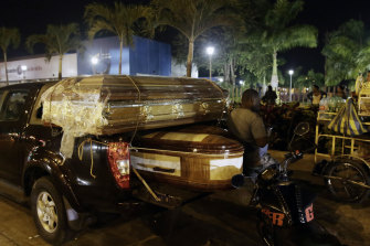 Coffins for the bodies of inmates sit on a truck outside the Guayaquil morgue.